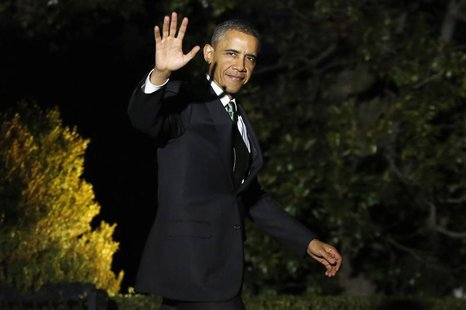 U.S. President Barack Obama waves to reporters as he departs for travel to Israel from the White House in Washington, March 19, 2013. REUTER