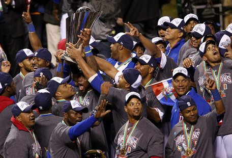 Dominican Republic players hold up the championship trophy after defeating Puerto Rico to win the their World Baseball Classic final in San