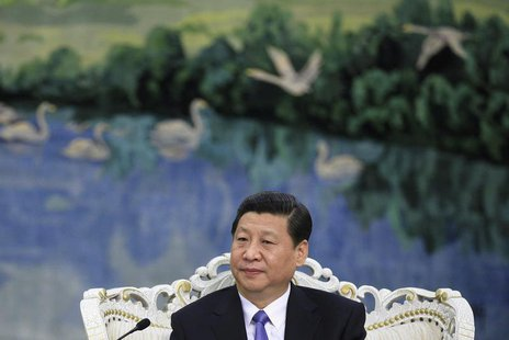 Chinese President Xi Jinping speaks to U.S. Treasury Secretary Jacob Lew (not pictured) during their meeting at the Great Hall of the People