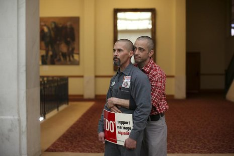 Same-sex couple Frank Capley (L) and Joe Alfano listen to a speaker at City Hall in San Francisco, California February 14, 2013. REUTERS/Rob