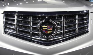 The front grill of a 2013 Cadillac SRX Crossover is shown at the 2012 New York International Auto Show at the Javits Center in New York, Apr