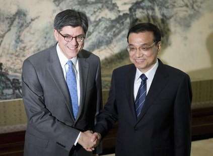 U.S. Treasury Secretary Jacob Lew (L) and Chinese Premier Li Keqiang pose for photographs before adjourning to their meeting at the Zhongnan