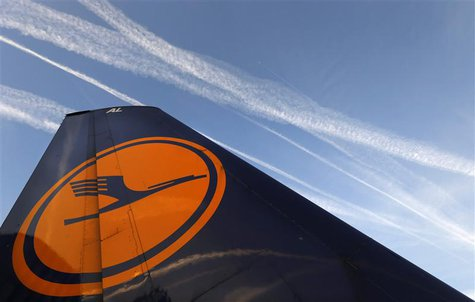 File photo of air planes flying over the Fraport airport, next to a Lufthansa aircraft tail fin, in Frankfurt, September 4, 2012. REUTERS/Ka