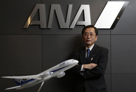 All Nippon Airways (ANA) Co's Senior Executive Vice President and next president Osamu Shinobe poses behind a model of ANA's Boeing Co's 787