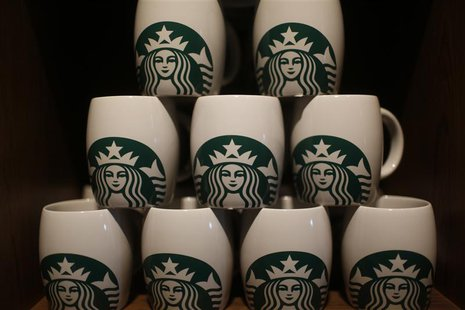 Starbucks coffee mugs are seen on display during the launch of the first Starbucks store in New Delhi, February 6, 2013. REUTERS/Adnan Abidi