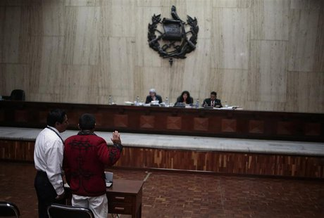 A indigenous man of the Ixchil region takes an oath to tell the truth during his testimony at the first session of the trial of the former G