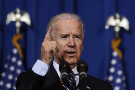 U.S. Vice President Joseph Biden talks before U.S. President Barack Obama signs the Violence Against Women Act while at the Department of In