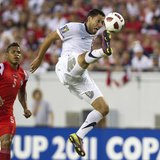 United States' Clint Dempsey takes a shot on goal near Panama's Roman Torres (L) during the first half of their CONCACAF Gold Cup soccer mat