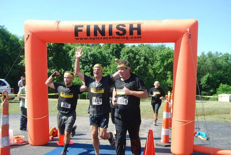 Participants cross the finish line during the 2012 Kalamazoo Mud Run.