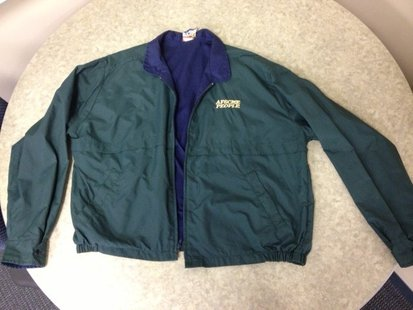 The type of jacket worn by the suspect.