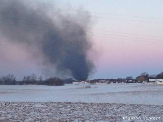 Smoke from a house fire rises over 5028 Dickinson in the town of Ledgeview, March 20, 2013. (courtesy of FOX 11).