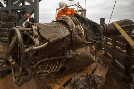 A heat exchanger from an Apollo F-1 engine is seen in this handout photo from Bezos Expeditions taken onboard a recovery ship off the coast