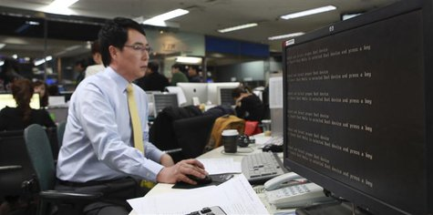 A computer is seen down after hacking at main office of broadcaster YTN in Seoul March 20, 2013. South Korean authorities were investigating