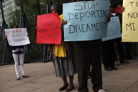 Activists hold posters during a demonstration calling for the government of U.S. President Barack Obama to stop deportations of Mexican and