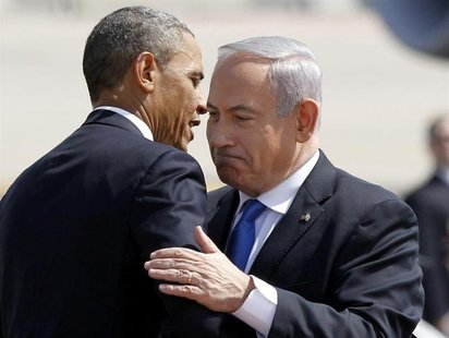 U.S. President Barack Obama hugs Israeli Prime Minister Benjamin Netanyahu at Ben Gurion International Airport Airport in Tel Aviv March 20,