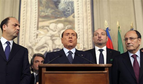 Italy's former Prime Minister Silvio Berlusconi (C) speaks after meeting with Italian President Giorgio Napolitano at Quirinale palace in Ro