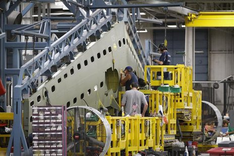 Cessna employees work on a tail section during a tour of the Cessna business jet assembly line at their manufacturing plant in Wichita, Kans