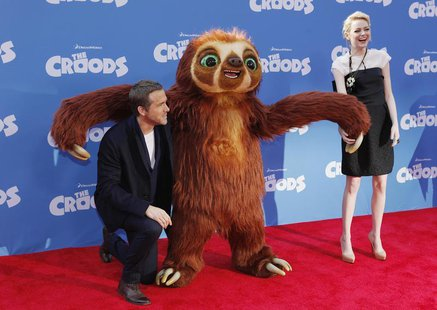 "Cast members Ryan Reynolds (L) and Emma Stone arrive for the premiere of the film ""The Croods"" in New York, March 10, 2013. REUTERS/Carlo Al"
