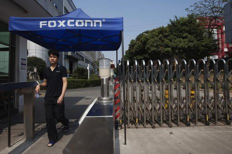 A worker leaves a Foxconn factory in the township of Longhua in Shenzhen, Guangdong province February 21, 2013. REUTERS/Tyrone Siu