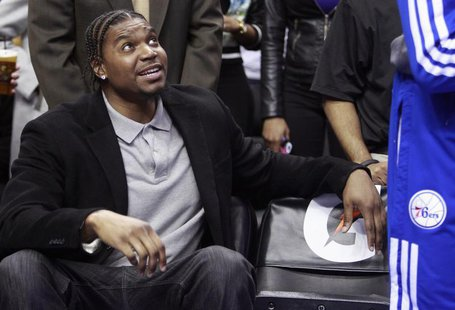 Injured Philadelphia 76ers center Andrew Bynum sits on the bench before the start of the Indiana Pacers versus the 76ers NBA basketball game