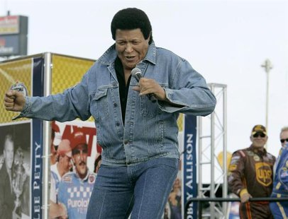Recording artist Chubby Checker performs before the running of the NASCAR Sprint Cup Series 50th Daytona 500 race at the Daytona Internation