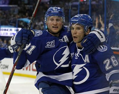 Tampa Bay Lightning's Steven Stamkos (L) celebrates his goal with teammate Martin St. Louis during the second period of their NHL hockey gam