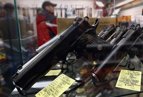 A display of 7-round .45 caliber handguns are seen at Coliseum Gun Traders Ltd. in Uniondale, New York January 16, 2013. REUTERS/Shannon Sta