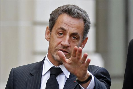 Former French President Nicolas Sarkozy reacts as he leaves his car in Paris November 26, 2012 after a lunch meeting with his former Prime M