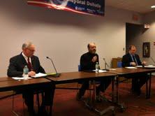 Mike Vandersteen, moderator Rick Dodgson of Lakeland College, Terry Van Akkeren