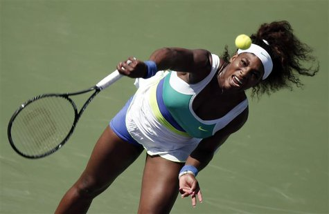 Serena Williams of the U.S. serves to Flavia Pennetta of Italy at the Sony Open tennis tournament in Key Biscayne, Florida March 21, 2013. R