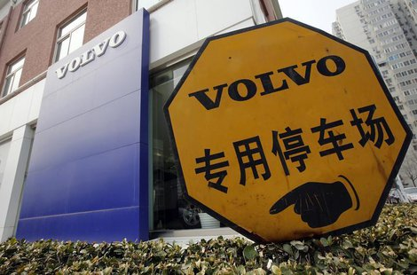 A parking signboard is seen in front of a Volvo logo at a dealer shop in Beijing March 21, 2013. REUTERS/Kim Kyung-Hoon
