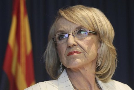 Arizona Governor Jan Brewer listens to a question from a media member about the Supreme Court's decision on SB1070 in Phoenix, Arizona, June