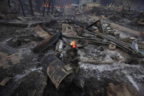 Burnt houses are seen in Meikhtila, March 21, 2013. REUTERS/Soe Zeya Tun
