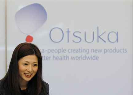 A receptionist works at the Otsuka Holdings Co headquarters in Tokyo December 15, 2010. REUTERS/Toru Hanai