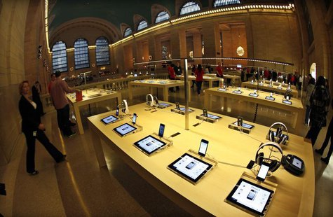 Apple iPad tabelts and iPhones are displayed inside the newest Apple Store in New York City's Grand Central Station December 7, 2011, during