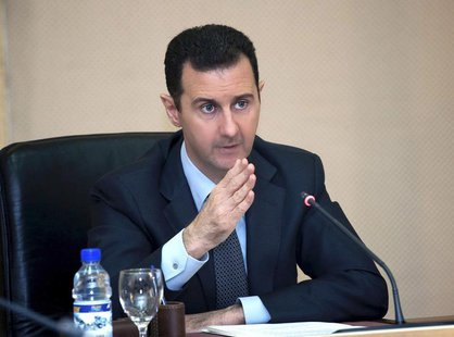 Syria's President Bashar al-Assad heads a cabinet meeting in Damascus, in this handout photograph distributed by Syria's national news agenc