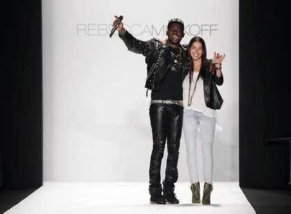 Designer Rebecca Minkoff smiles and waves with a musician after presenting her Fall/Winter 2012 collection during New York Fashion Week Febr
