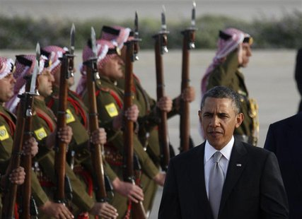 U.S. President Barack Obama is greeted by Bedouin Jordanian honour guards upon his arrival at Amman airport, March 22, 2013. REUTERS/Ali Jar