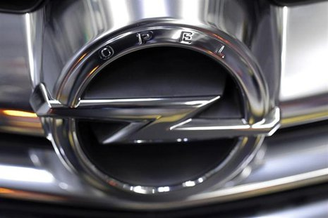 The Opel logo is placed on a Cascada model at an assembly line at the Opel Gliwice factory in southern Poland February 28, 2013. REUTERS/Pet