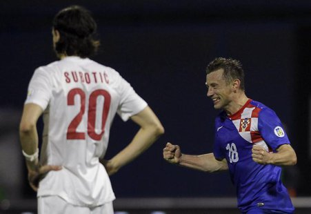 Croatia's Ivica Olic (R) celebrates after scoring against Serbia during their 2014 World Cup qualifying soccer match at Maksimir stadium in