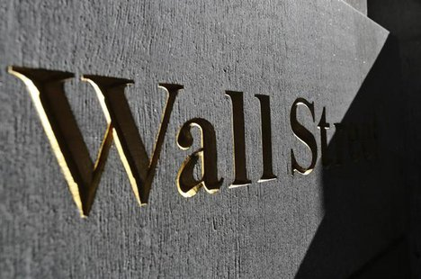 Wall Street is written on a building in New York's financial district, March 4, 2013. REUTERS/Brendan McDermid