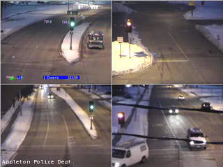 Appleton police are looking to identify the van seen in the lower right box of this traffic camera photo. Officers believe the van was involved in a hit-and-run crash in the parking lot of Copps on Calumet St., March 19, 2013.