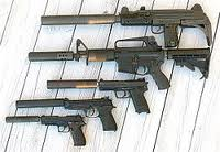 Silencers attached to weapons.  Photo courtesy Wikipedia.