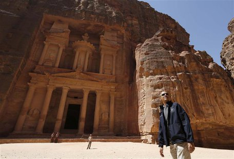 President Barack Obama stops to look at the Treasury as he takes a walking tour of the ancient historic and archaeological site of Petra Mar