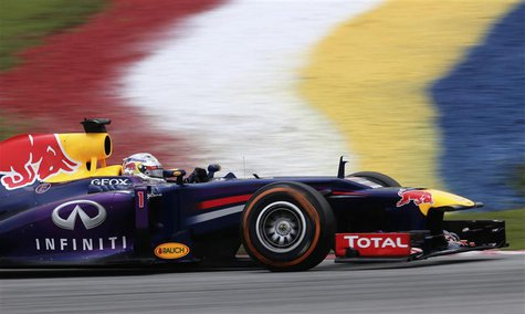 Red Bull Formula One driver Sebastian Vettel of Germany drives during the third practice session of the Malaysian F1 Grand Prix at Sepang In