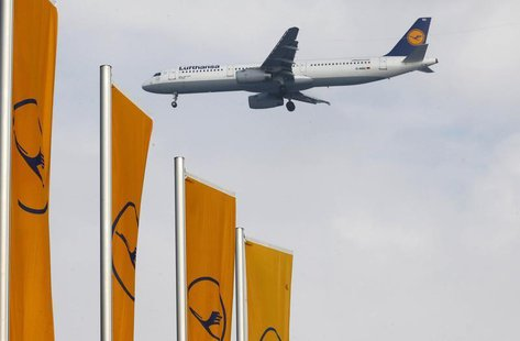An airplane of German air carrier Lufthansa lands at the airline's main hub, the Fraport airport in Frankfurt, March 14 2013. REUTERS/Kai Pf
