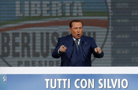 Italy's former Prime Minister Silvio Berlusconi gestures during a meeting in Rome March 23, 2013. REUTERS/Yara Nardi