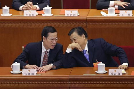 China's Politburo Standing Committee member Liu Yunshan (R) talks to newly-elected Vice-Premier Zhang Gaoli during the sixth plenary meeting
