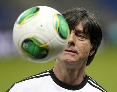 Germany's national soccer team head coach Joachim Loew attends a training session ahead of their 2014 World Cup qualifying soccer match agai