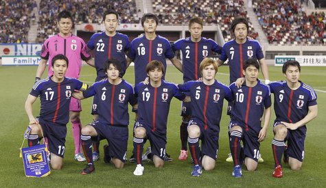 Japan's players pose for a group picture before their international friendly soccer match against Canada in Doha March 22, 2013. REUTERS/Moh